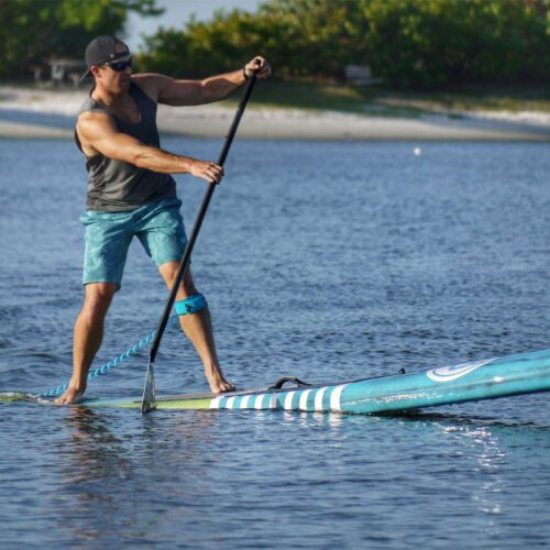 Garret McCoy personal trainer on a paddleboard in Tampa