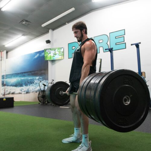 Michael Leotsakos deadlifting inside at Pure Strength and Movement gym in Tampa, Florida